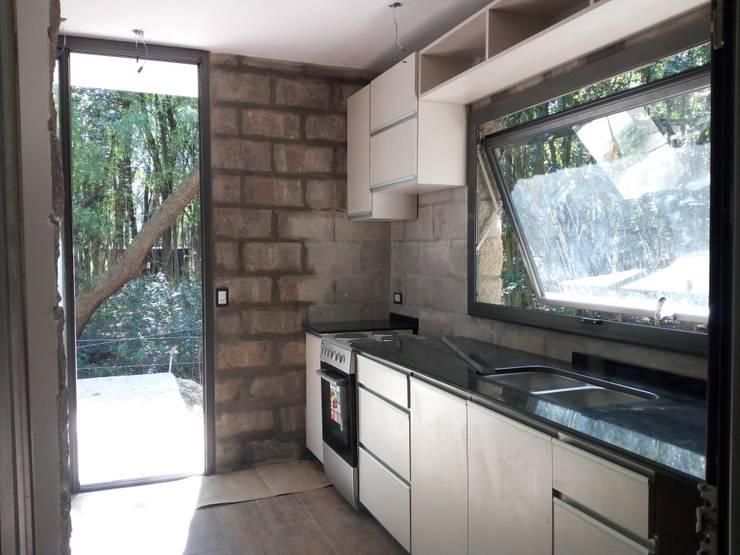 Cocinas integrales de estilo  de Marcelo Manzán Arquitecto,