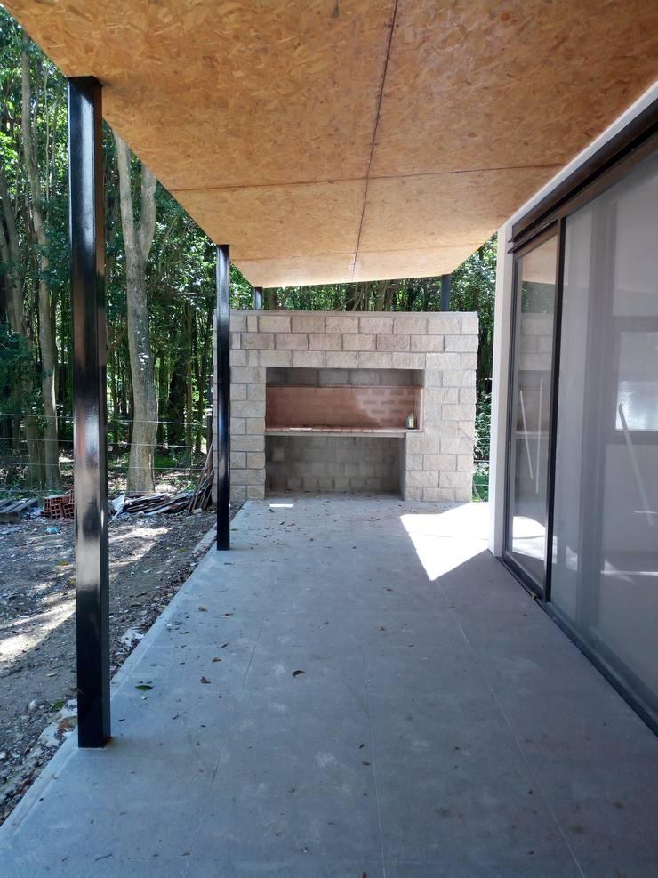 Casas rurales de estilo  de Marcelo Manzán Arquitecto,
