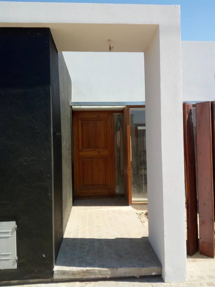 Una casa llena de rincones: Casas de estilo  por Marcelo Manzán Arquitecto,Moderno