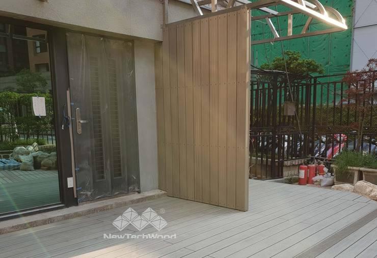 Casas multifamiliares de estilo  por 新綠境實業有限公司,