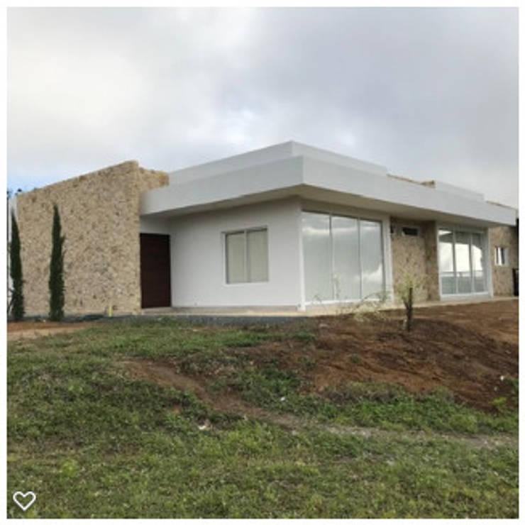 Casas de campo de estilo  por Arcor Constructores , Moderno