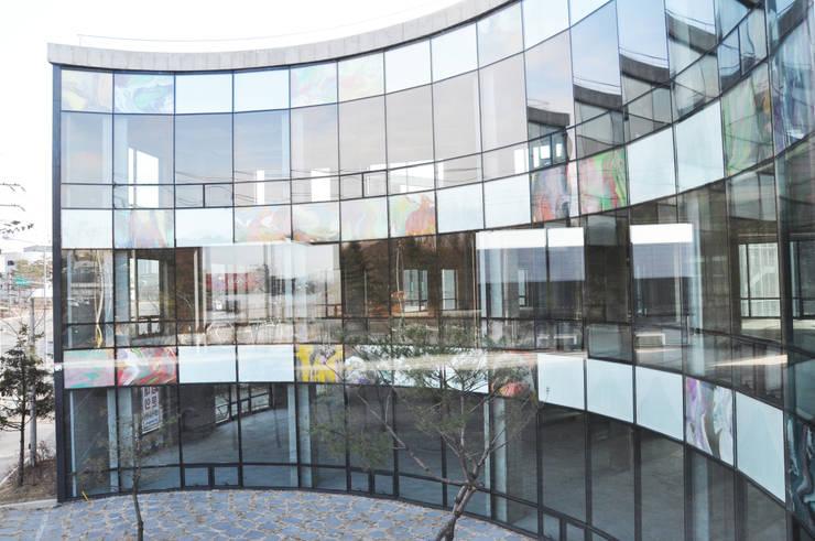 Enchanter( 앙샹떼)_풍동 근린생활시설: 건축사사무소 이가소 / igaso architects & planners 의  상업 공간