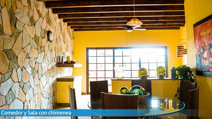 Calor de hogar: Comedores de estilo  por VillaSi Construcciones