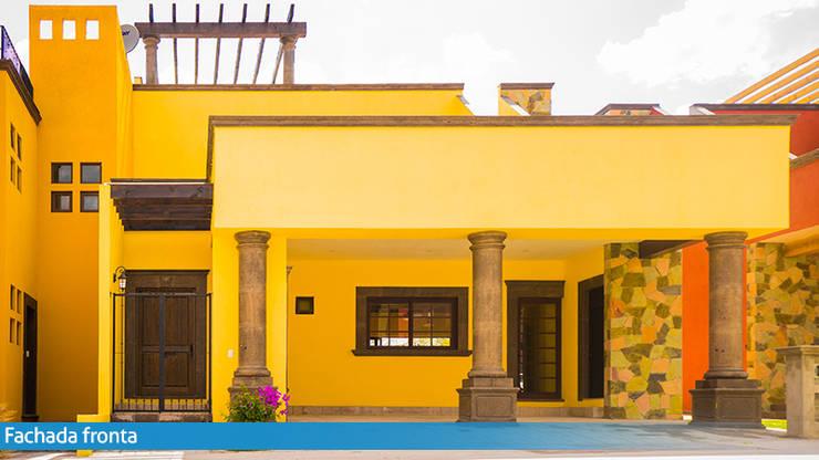 Tonalidades cálidas: Casas de campo de estilo  por VillaSi Construcciones
