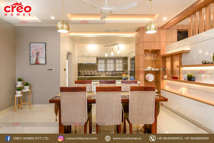 Dining room by CreoHomes Pvt Ltd