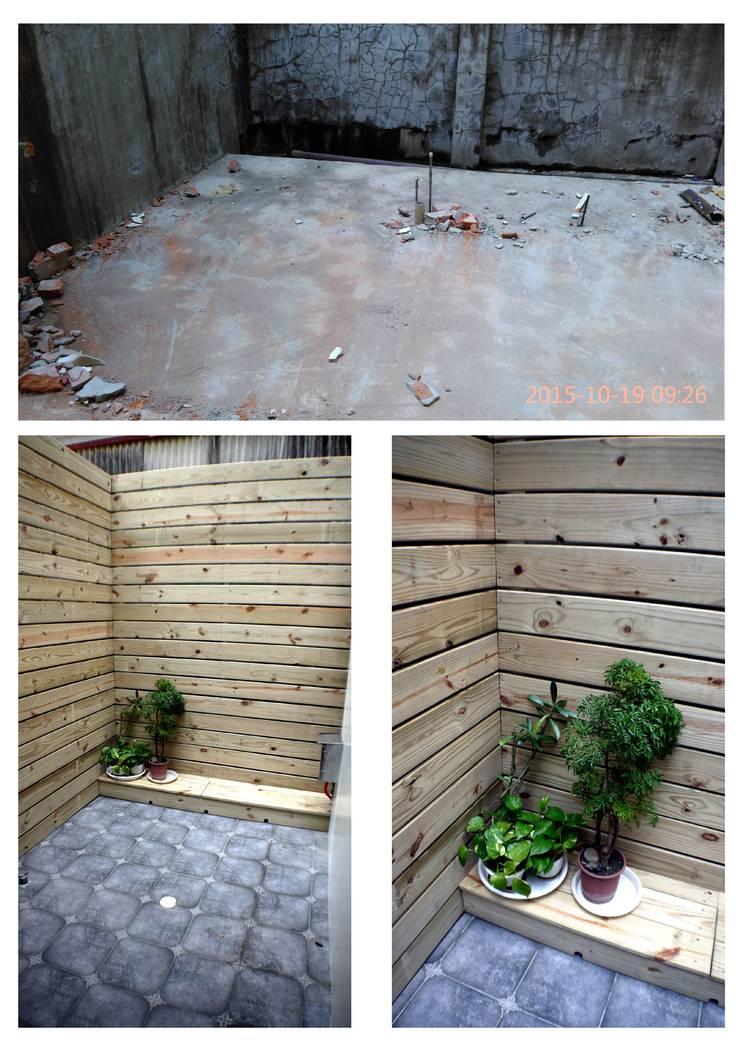 庭園柵欄使用淺色木板:  花園 by 奕禾軒 空間規劃 /工程設計