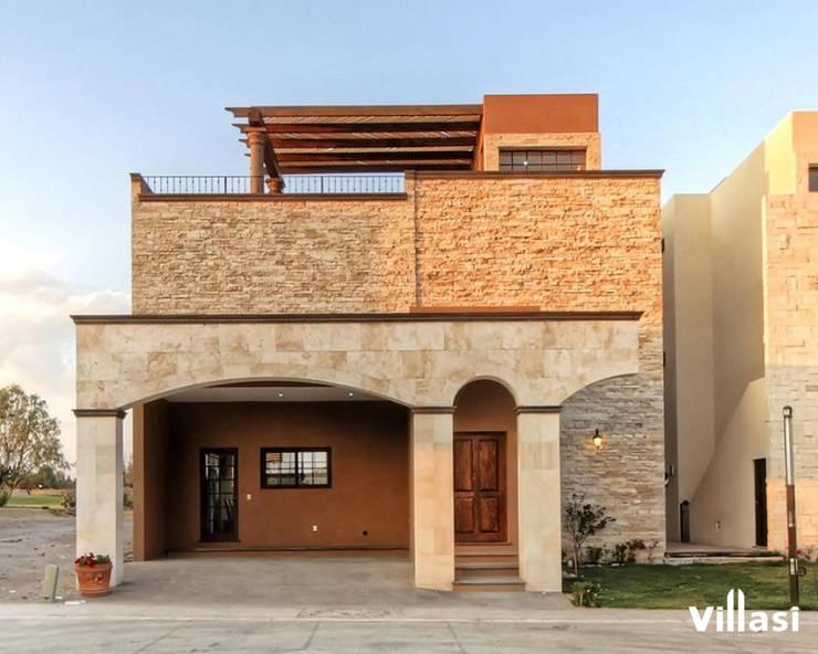 Encanto rústico: Casas de campo de estilo  por VillaSi Construcciones