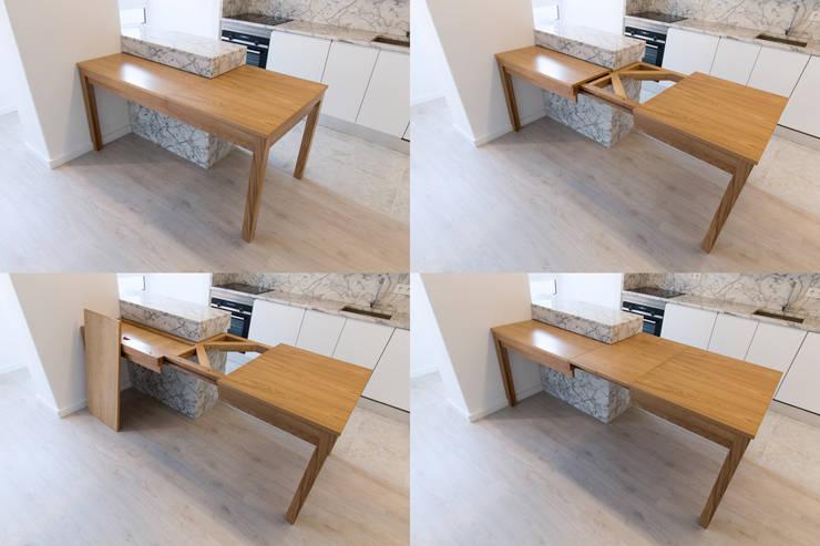 Ilha e mesa extensível: Cozinha  por BL Design Arquitectura e Interiores