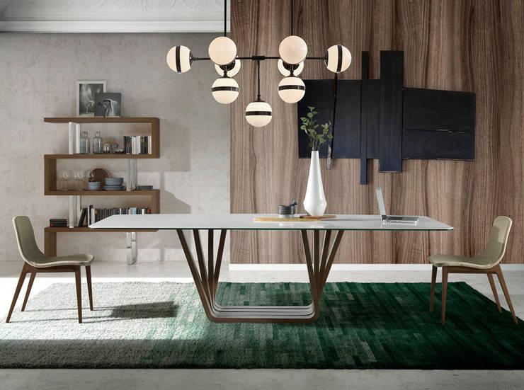 Comedor de diseño con muebles de la colección Atelier by Angel Cerdá: Comedor de estilo  de ANGEL CERDA