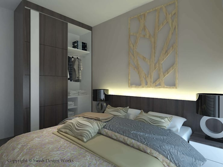 Master bedroom with opened wardrobe:  Small bedroom by Swish Design Works