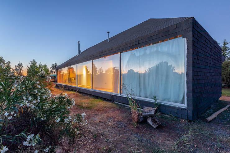 Casa en el Ramal: Casas de estilo  por mutarestudio Arquitectura