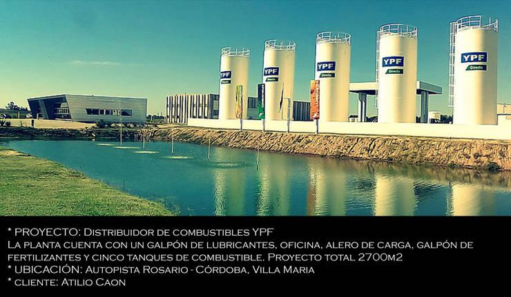 Distribuidor de combustibles YPF: Estudios y oficinas de estilo  por Arq Jennifer Morant ,