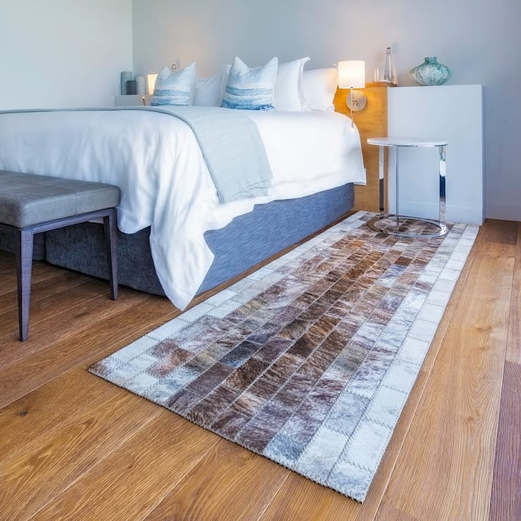 Bespoke hand-stitched cowhide rugs:  Bedroom by Inkomo Products