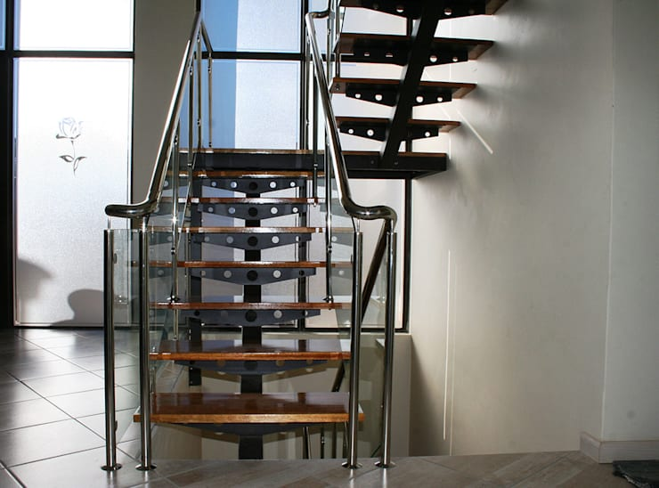 Metallic Office Staircase:  Stairs by Renov8 CONSTRUCTION