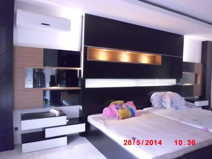 Master Bedroom:  Bedroom by bellopremiumdesign