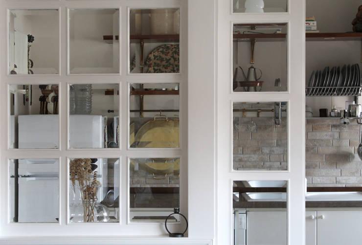 Ventanas de estilo  por Caleidoscopio Architettura & Design, Clásico