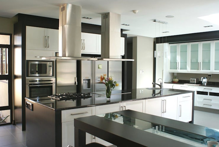 Mixing Colours and materials to create modern touch:  Built-in kitchens by Signature Kitchens
