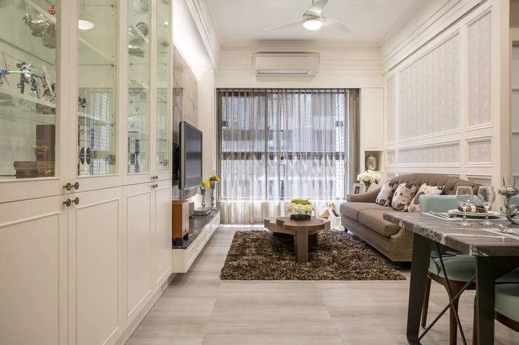 英倫雅致-上河園:  客廳 by 富亞室內裝修設計工程有限公司