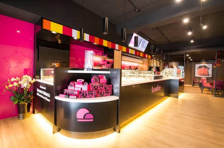 繽紛色彩穿插其中的泡芙專賣店,彷彿身處法式烘焙商店的氛圍,來一趟其妙的午后約會...:  餐廳 by 富亞室內裝修設計工程有限公司