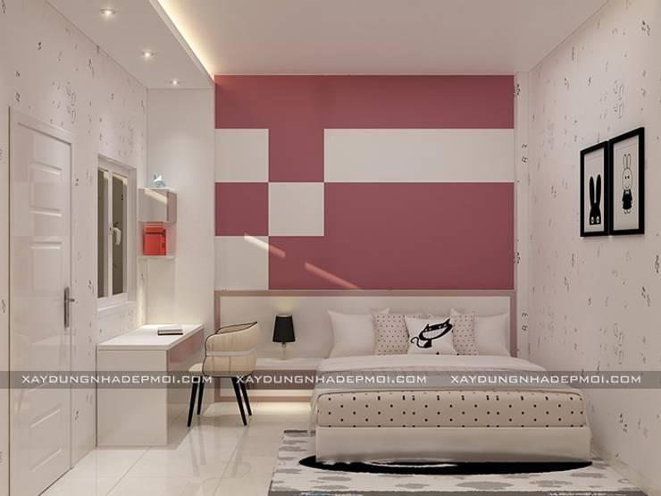 Nhà phố 1 trệt 2 lầu đẹp:  Phòng ngủ by Công ty xây dựng nhà đẹp mới