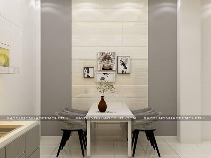 Nhà phố 1 trệt 2 lầu đẹp:  Phòng ăn by Công ty xây dựng nhà đẹp mới