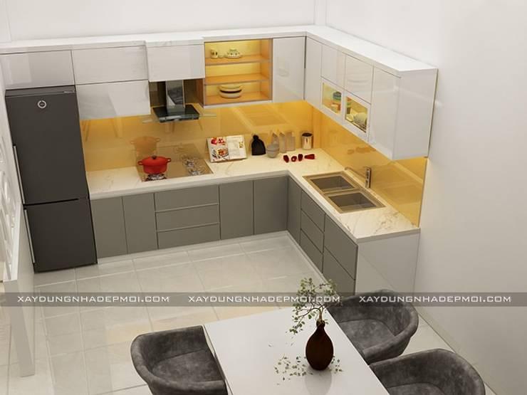 Nhà phố 1 trệt 2 lầu đẹp:  Nhà bếp by Công ty xây dựng nhà đẹp mới