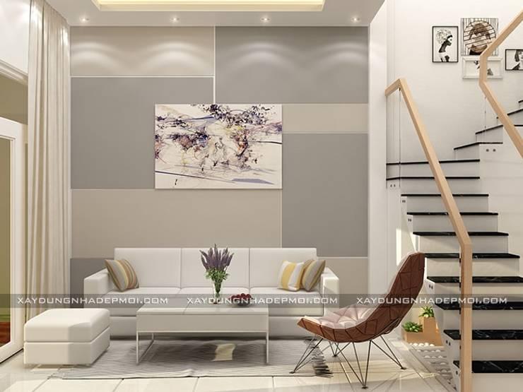 Nhà phố 1 trệt 2 lầu đẹp:  Phòng khách by Công ty xây dựng nhà đẹp mới