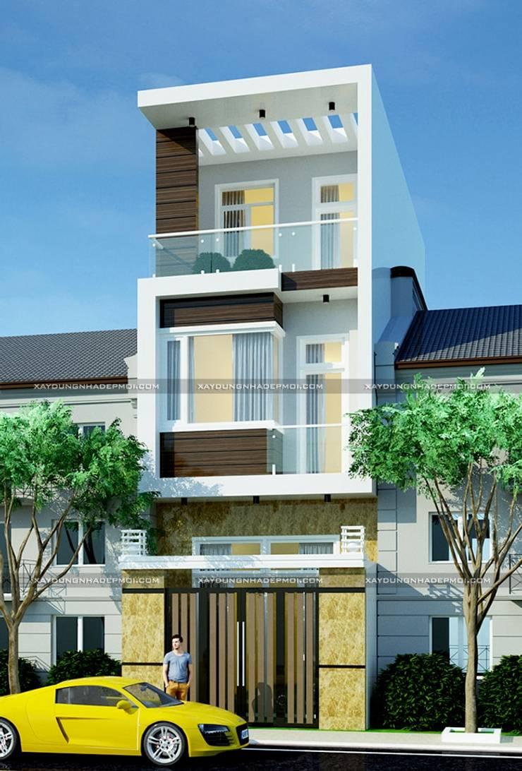 Nhà phố 1 trệt 2 lầu:  Nhà by Công ty xây dựng nhà đẹp mới