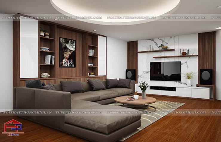 Ý tưởng thiết kế nội thất phòng khách gỗ công nghiệp An Cường nhà anh Phương ở Thanh Hóa:  Living room by Nội thất Hpro