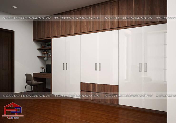 Thiết kế nội thất phòng ngủ nhà anh Phương - Thiết kế tủ quần áo và bàn làm việc trong phòng ngủ master:  Bedroom by Nội thất Hpro