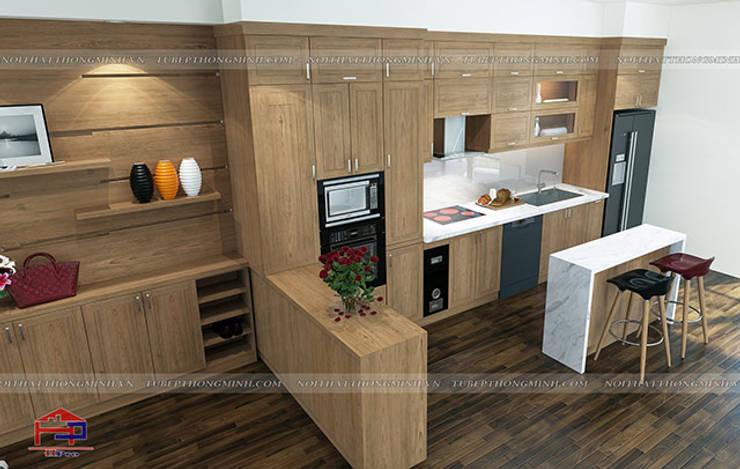 Ảnh thiết kế 3D tủ bếp gỗ sồi mỹ kèm bàn đảo nhà chú Lấu ở Triều Khúc:  Kitchen by Nội thất Hpro