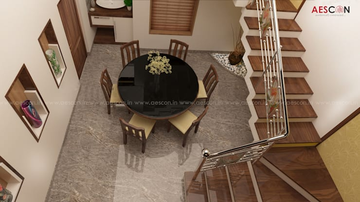 Dining room by Aescon Builders and Architects