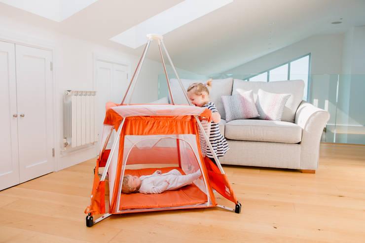 BabyHub SleepSpace travel cot in tangerine:  Nursery/kid's room by Babyhub Ltd