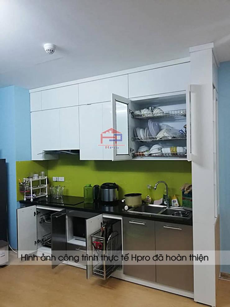 Hình ảnh thực tế tủ bếp acrylic nhà anh Điệp sau khi được lắp đặt đầy đủ phụ kiện và thiết bị đi kèm:  Kitchen by Nội thất Hpro
