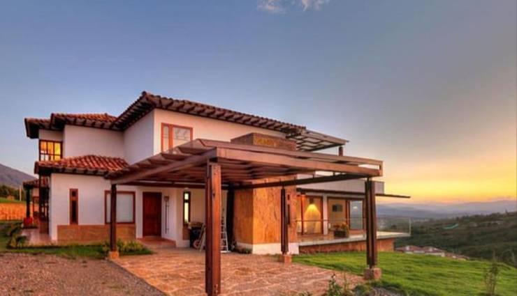 atardecer.: Terrazas de estilo  por cesar sierra daza Arquitecto
