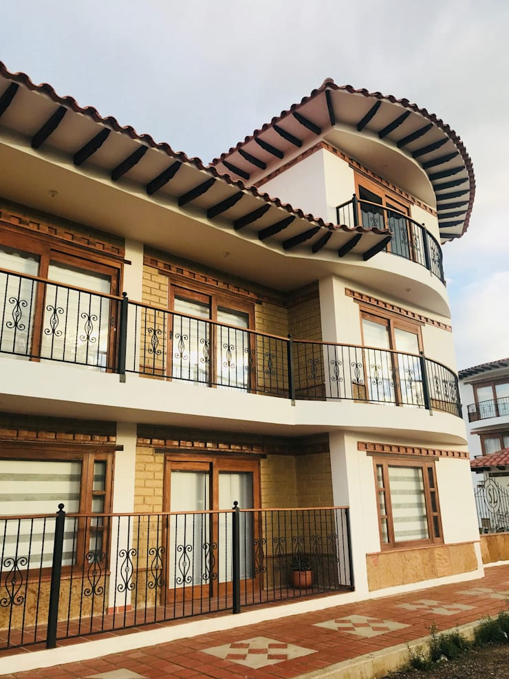 Detalle de acabados fachada principal: Casas multifamiliares de estilo  por cesar sierra daza Arquitecto