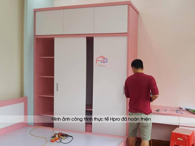 Thi công tủ quần áo gỗ công nghiệp An Cường trong phòng ngủ bé gái nhà anh Toản ở Lạng Sơn:  Bedroom by Nội thất Hpro