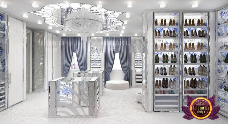 Spacious Metallic Wardrobe Design:   by Luxury Antonovich Design