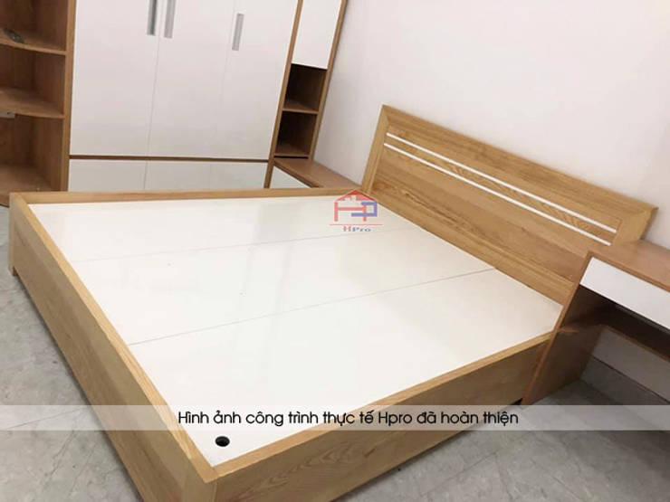 Ảnh thực tế nội thất phòng ngủ của bé gỗ công nghiệp melamine An Cường nhà chị Hiền ở Nam Định:  Bedroom by Nội thất Hpro