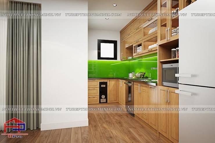 Ảnh 3D thiết kế tủ bếp gỗ sồi mỹ chữ L nhà chị Lê ở Định Công:  Kitchen by Nội thất Hpro