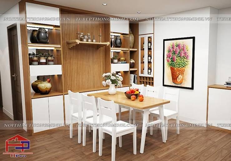 Ảnh thiết kế 3D tủ trang trí gỗ công nghiệp An Cường nhà chị Lê:  Dining room by Nội thất Hpro