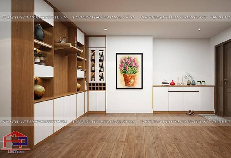 Ảnh thiết kế 3D tủ trang trí và tủ giày nhà chị Lê ở Định Công:  Dining room by Nội thất Hpro