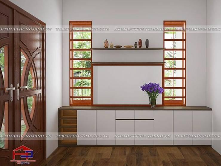 Ảnh 3D thiết kế tủ đựng giày gỗ melamine nhà anh Năng ở Nam Định:  Living room by Nội thất Hpro