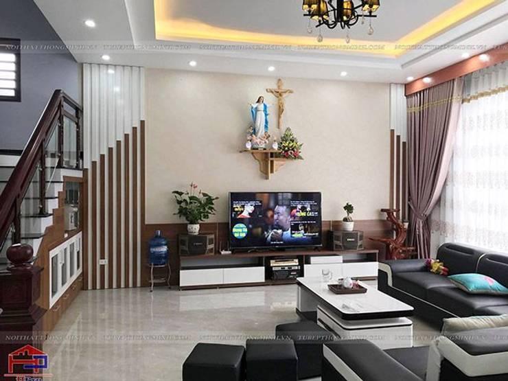 Ảnh thực tế nội thất phòng khách gỗ melamine nhà anh Năng ở Nam Định sau khi hoàn thành thi công:  Living room by Nội thất Hpro