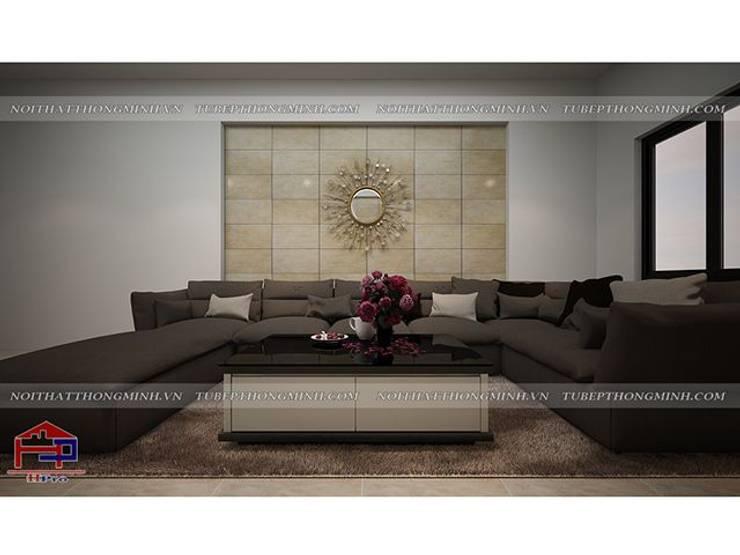 Ảnh thiết kế nội thất phòng khách gỗ công nghiệp An Cường nhà chị Giang ở Quảng Ninh - view 2:  Living room by Nội thất Hpro