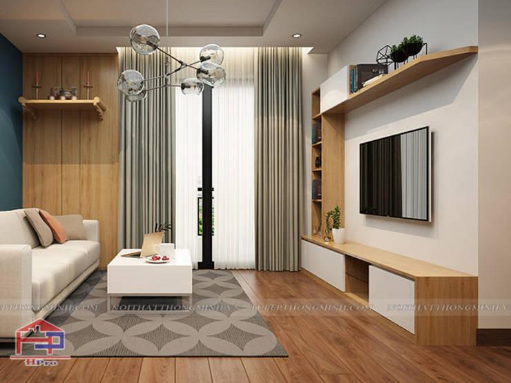 Ảnh 3D thiết kế nội thất phòng khách gỗ công nghiệp nhà chị Hường tại Chung cư Hà Nội Center Point:  Living room by Nội thất Hpro