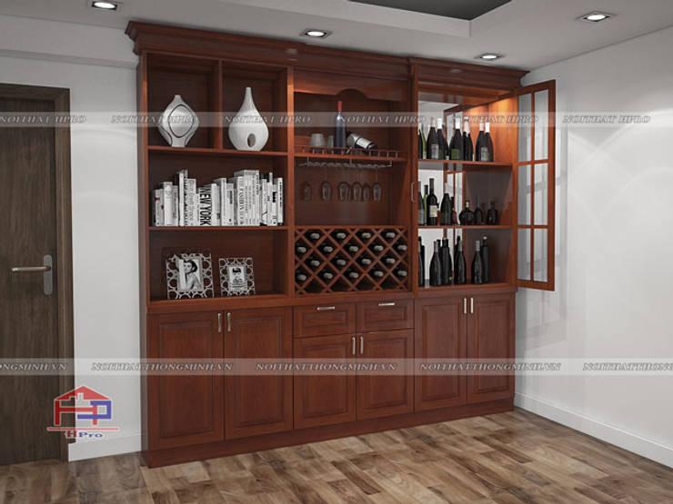 Ảnh 3D thiết kế nội thất phòng khách gỗ xoan đào nhà anh Trọng ở Linh Đàm - view 2:  Living room by Nội thất Hpro