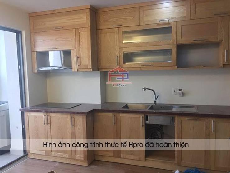Hoàn thiện lắp đặt tủ bếp gỗ sồi nga chữ I nhà cô Huyền ở Trung Kính:  Kitchen by Nội thất Hpro