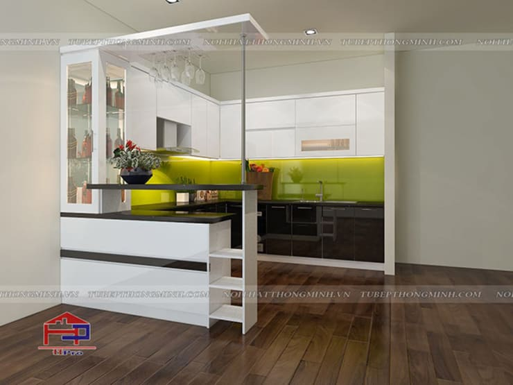 Ảnh thiết kế tủ bếp acrylic kèm bàn đảo nhà anh Tân ở Thạch Bàn:  Kitchen by Nội thất Hpro