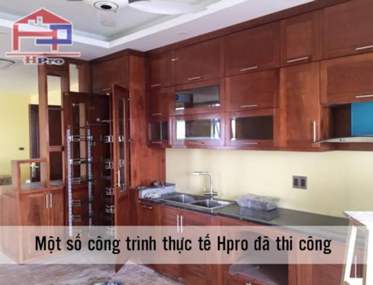 Hoàn thiện thi công tủ bếp gỗ xoan đào nhà chị Loan ở Thụy Khuê:  Kitchen by Nội thất Hpro
